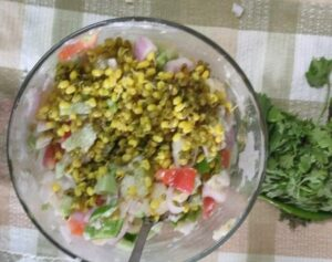 mixing raw cucumber, onion with mashed potatoes salad dressing
